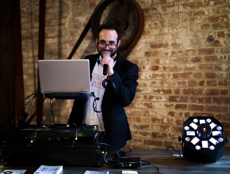 DJ on the microphone - time to announce the bride and groom! MC services included in your DJ package. Book today! https://www.djmichaeldemby.com/booknow/