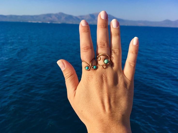 Hammered bronze rings with semiprecious turquoise stones made by Macramilia Creations,