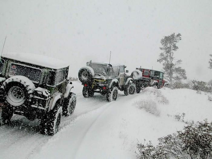 Jacked Up Jeep Wrangler >> When one Jeep owner calls another.. A jeep convoy happens in the snow to raise a little hell ...