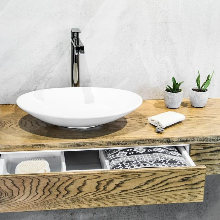 Achieve weightless elegance and charm by pairing a 500mm Feather Basin with a wall hung splice vanity, available in a wide variety of Caesarstone, Engineered Veneer, Meganite, and Freestyle colours at a range of suppliers including @beaumont.tiles. #TimberlineDesign #SpliceVanity