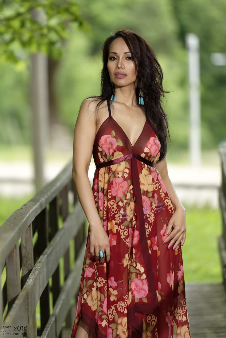 Amber and her floral long see through dress..