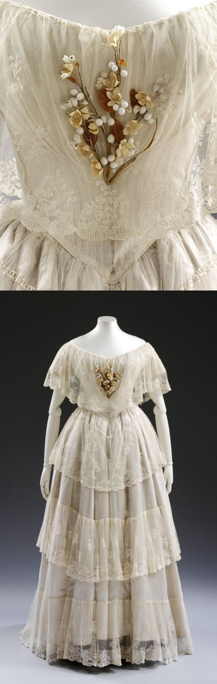 White silk satin wedding dress ensemble with overdress of embroidered flounced net lace, UK, 1848