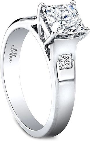 Jeff Cooper Burnish Princess Cut Diamond Engagement Ring: This diamond engagement ring by Jeff Cooper features a burnish set princess cut diamond on either side of the center stone of your choice.