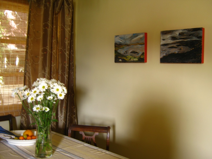 Paintings of Scotland by my Czech brother in law in my Canadian dining room.Dining Room
