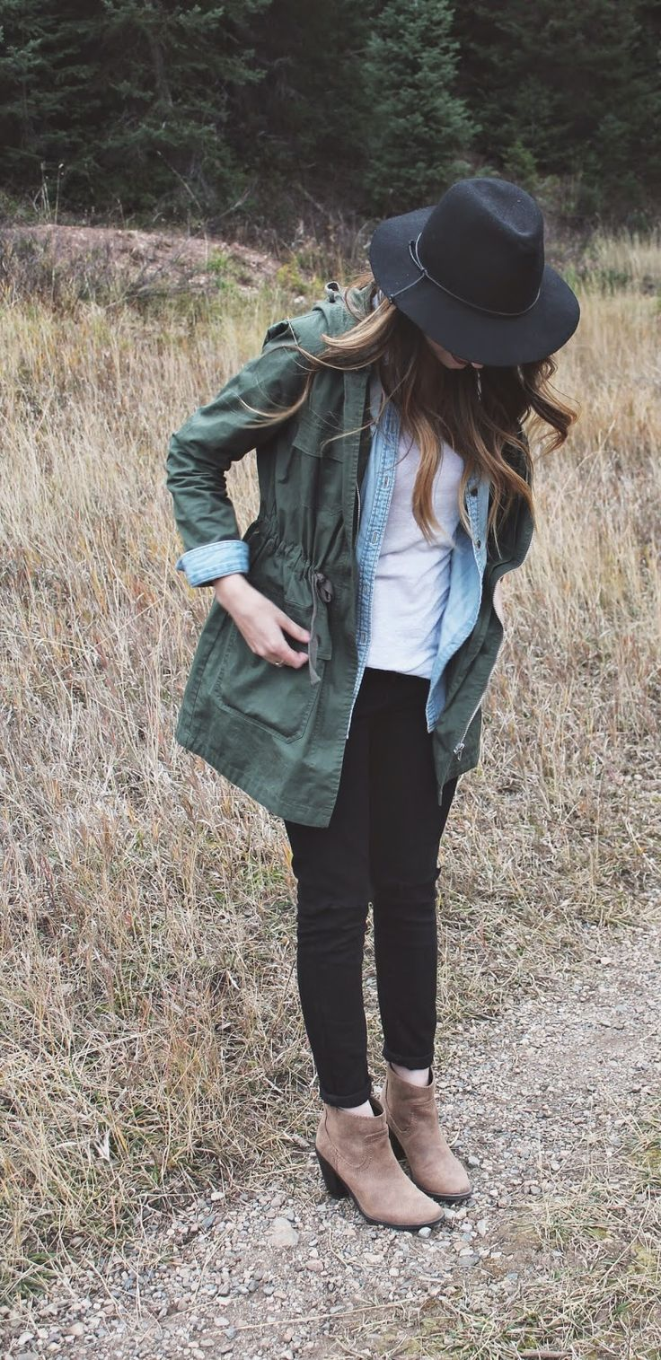 olive cargo jacket, long sleeve light denim shirt, white tee, black rolled up jeans , tan ankle boots & black hat