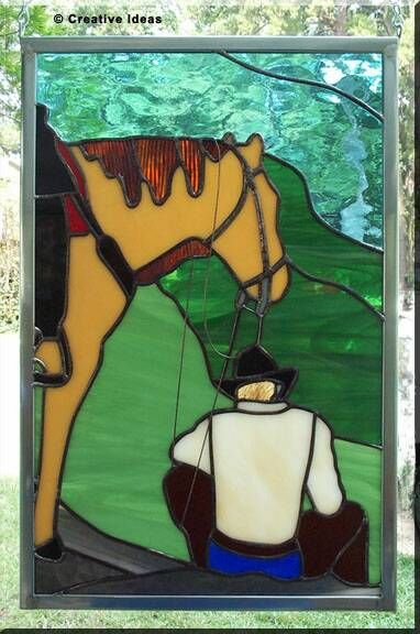 stained glass..A beautiful piece to hang in a window on a ranch.