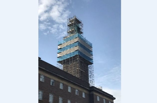 The rivalry between Ipswich Town and Norwich City has reached new heights after the famous colours of the Blues appeared wrapped around Norwich's clock tower, which is undergoing repair work.