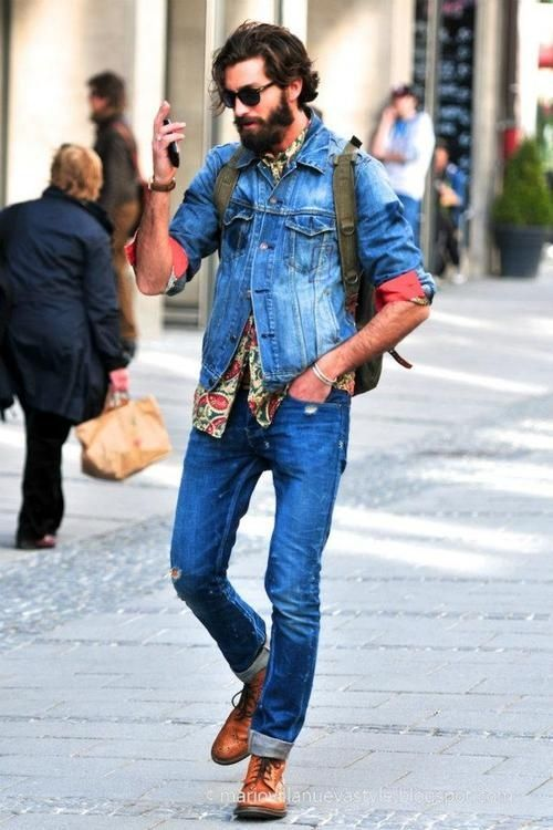 Shop this look on Lookastic:  http://lookastic.com/men/looks/sunglasses-long-sleeve-shirt-denim-jacket-backpack-skinny-jeans-brogue-boots/8294  — Black Sunglasses  — Olive Paisley Long Sleeve Shirt  — Blue Denim Jacket  — Olive Canvas Backpack  — Blue Ripped Skinny Jeans  — Brown Leather Brogue Boots