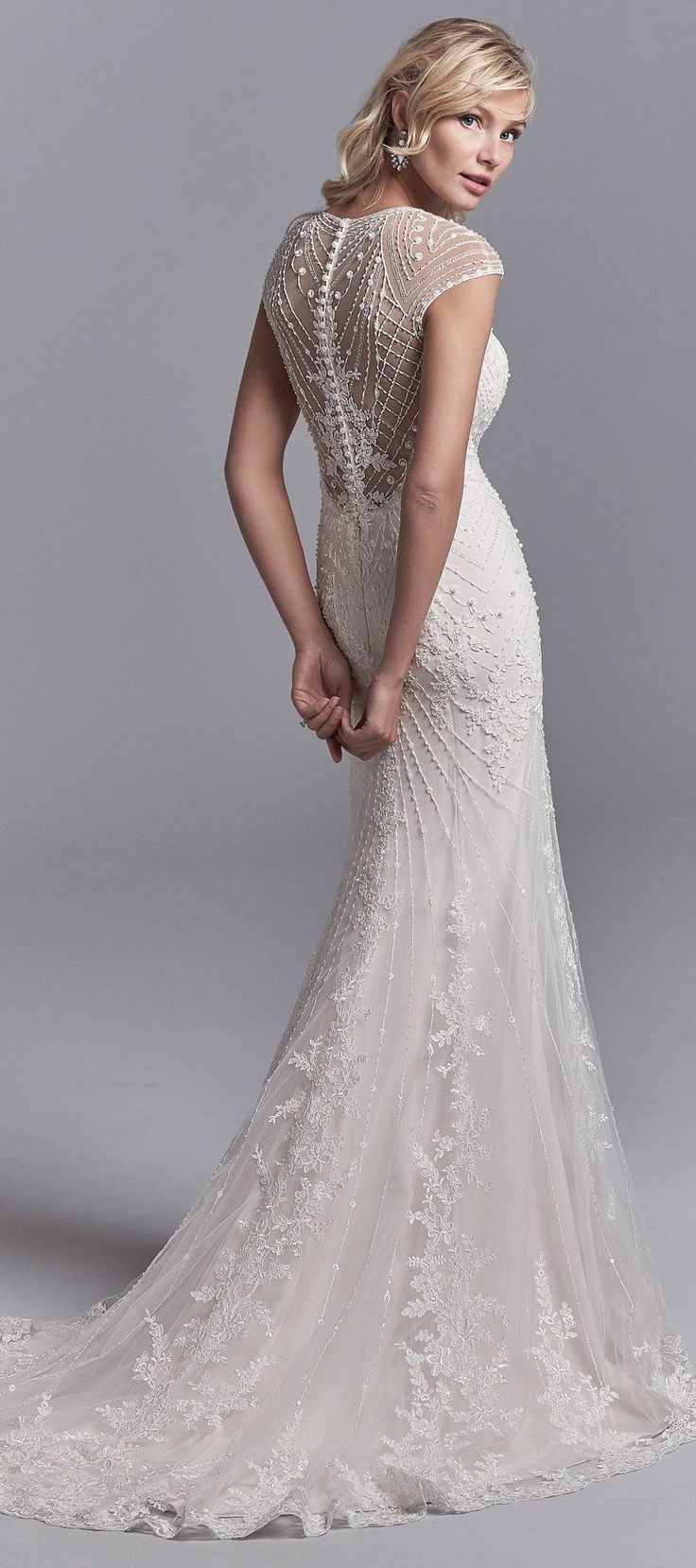 Grady features unique geometric lace motifs and luxe lining. See more from the Khloe Collection by Sottero and Midgley on the website!