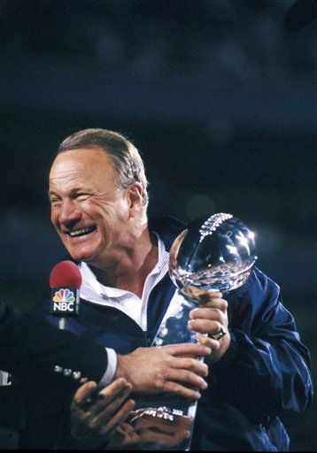 Dallas Cowboys head coach, Barry Switzer, holds the Lombardi trophy after winning Super Bowl XXX on January 28, 1996.