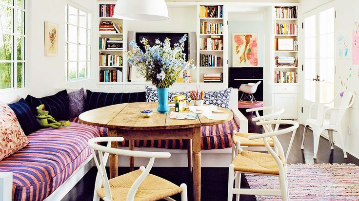 warm woods, bright walls, colorful accents in Amanda Peet's breakfast nook // dining rooms