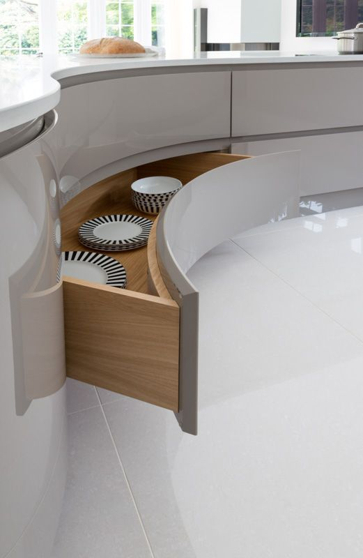 High gloss curved drawer with handless detail.