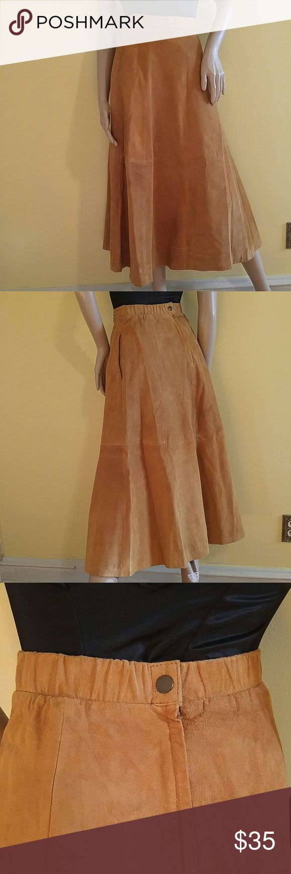 """Vintage Suede Tan Maxi Skirt. Vintage Suede Tan Maxi Skirt.. Lovely Condition! Fully Lined. Exact measurements are: Length : 37"""" Waist: 26"""" -27"""" back elastic waist 2 Side Pockets  Label: Hunt Club size 6 Vintage Skirts"""