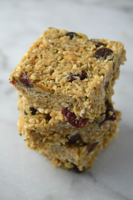 Super healthy no bake hemp hearts and coconut squares made with chocolate chips, dried cranberries and peanut butter. Vegan, gluten free snack food!
