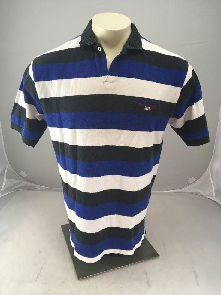 """Vintage polo sport Ralph Lauren men's straight black white and blue polo shirt. Embroidered flag and logo on the front. Good vintage condition with no rips or holes stains or tears. There is some fading throughout the shirt from the age. Please look at photos and feel free to ask any questions you may have. Thank you for taking a look!  Measurements Pit to pit-24"""" Length-30"""" We work hard to describe, ship and respond to all of your n..."""