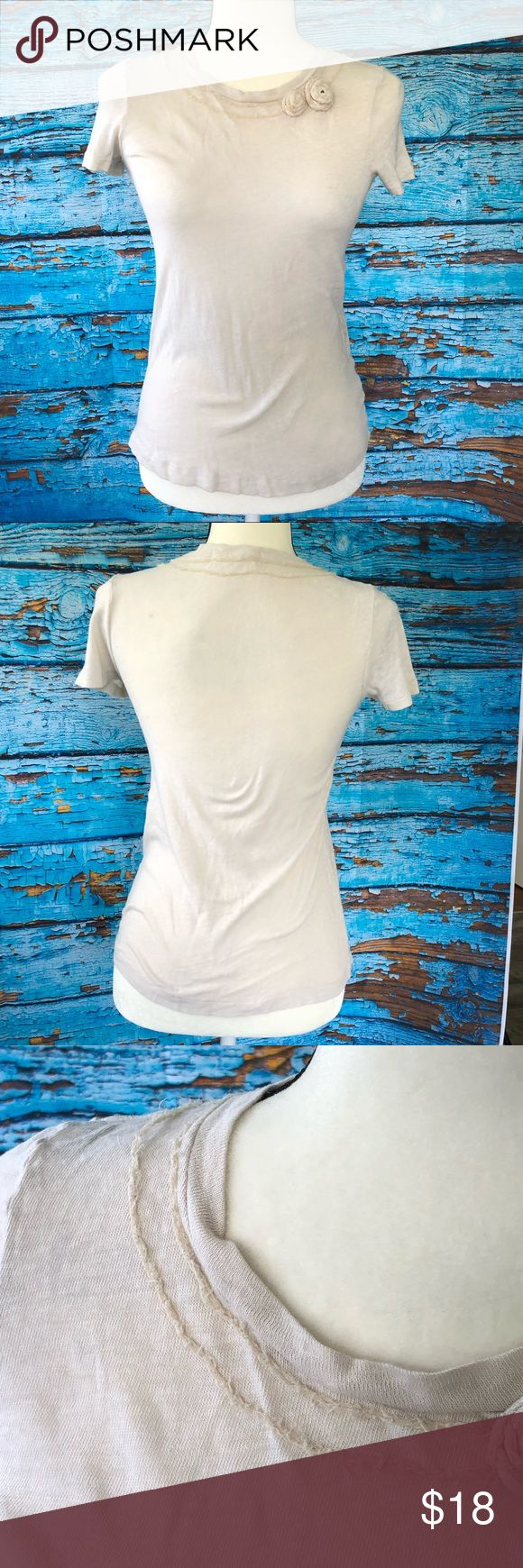 J. Crew embellished Top Gorgeous dainty flower embellishments and around entire neckline. Labeled Small but it's a thinner very stretchy material, therefore could fit XXS to Med.  Very flattering with a scooped neckline.  EUC: no tears or stains J. Crew Tops Tees - Short Sleeve