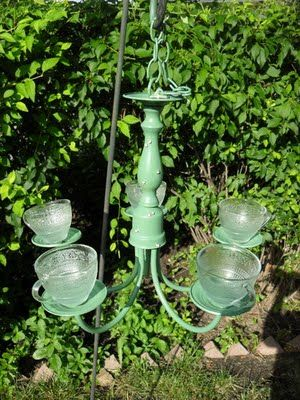 """Thanks to """"Wonderfully Made"""" for the inspiration to try making one of these brass chandellier bird feeders!  I bought one at the Habitat Re-Store for $15, spray painted it a pretty plum color, glued on some clear punch cups I bought at a thrift store and hung it from a tree! The birds loved it!!  (I love it too!)"""