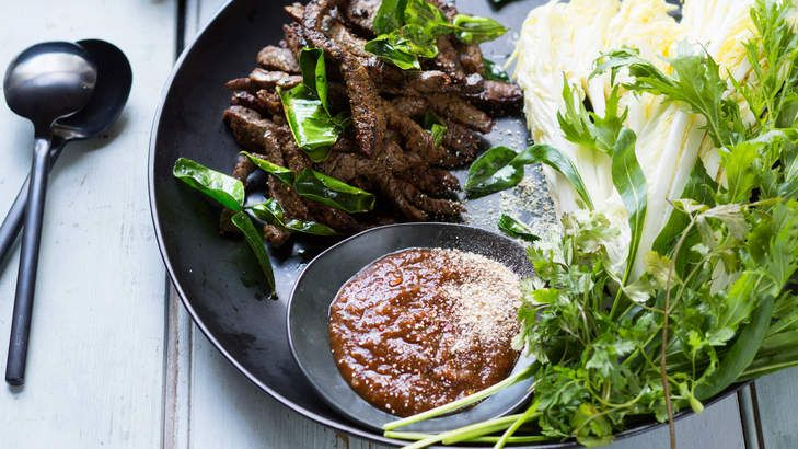 Karen Martini's version of a classic Thai fried beef dish traditionally features sun-dried, then deep-fried, beef with a chilli sauce. The result is reminiscent of beef jerky, with a chewy, dry texture and deeply savoury flavour.