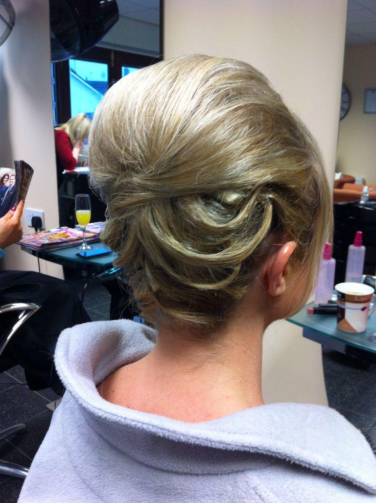 Bouffant beehive sleek hair up updo wedding hair occasion