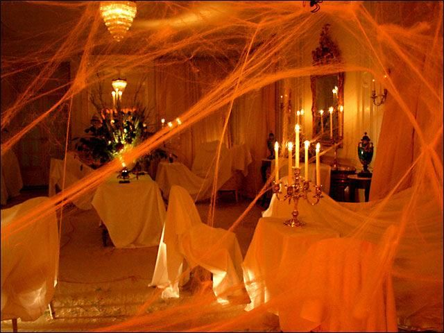 halloween party decor lippi lippi riemen chaney white sheets fake cobwebs candelabra and colored light bulbs brilliant - Halloween Rental Decorations