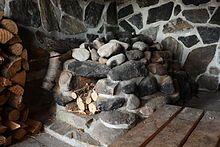 Interior of a smoke sauna (savusauna) in Utsjoki, Finland - by Matti Paavola