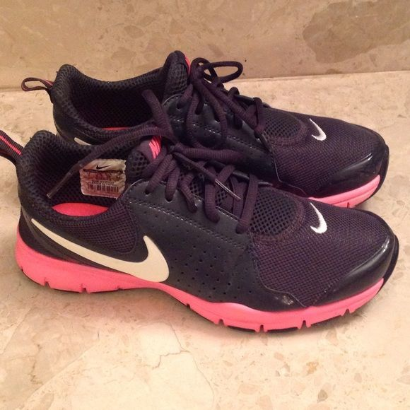 Nike Training Shoe  Nike training shoe, size 7. Cute color in Navy and Pink with the white Nike insignia on the front and sides.  Almost new. Worn once.  Slight scratches at toe. These are the best in comfort and style.  Feels super comfortable with the memory foam cushion on the inside soles. The laces are also in excellent condition. Nike Shoes Athletic Shoes