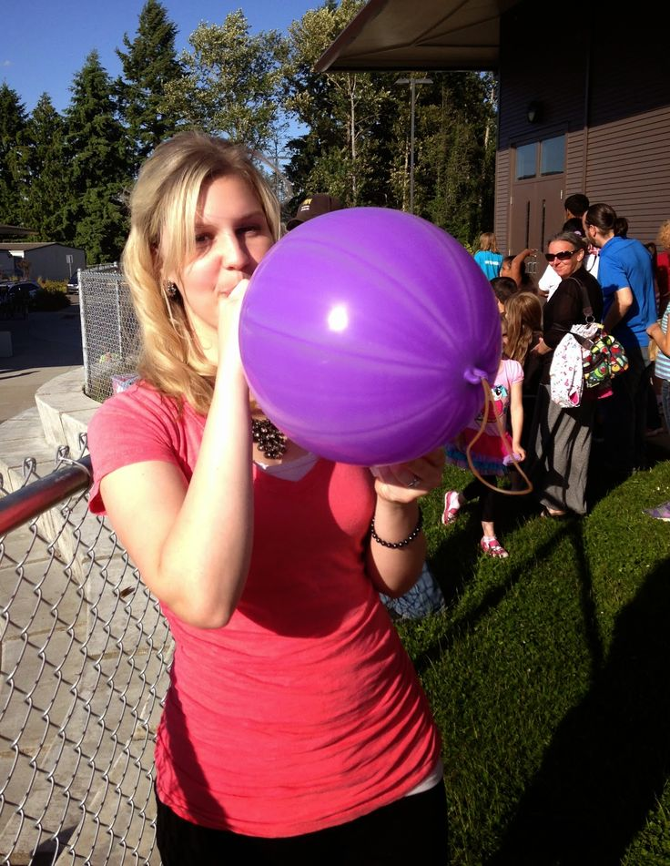 Girl Blowing Up Balloons Blowing Up The Balloons The Girls Won In The