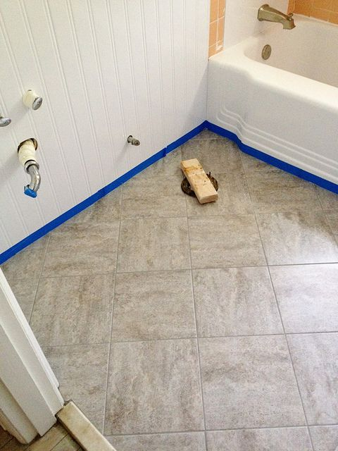 Remodelaholic | Bathroom Redo: Grouted Peel and Stick Floor Tiles  This is for you Amelai! I think we could do this for your bathrooms!!