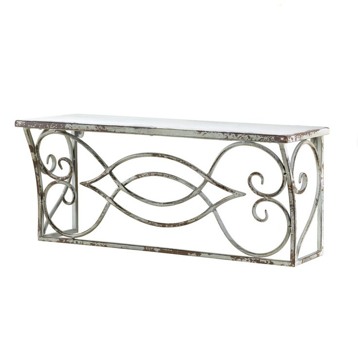 LARGE SCROLLWORK WALL SHELF This large shelf is a timeless classic that looks like it has weathered the years with grace and style. The scrolling framework design is topped by a rectangular shelf and finished to look like an antique treasure. It's a romantically stylish way to display your favorite collectibles, decor, books and more!