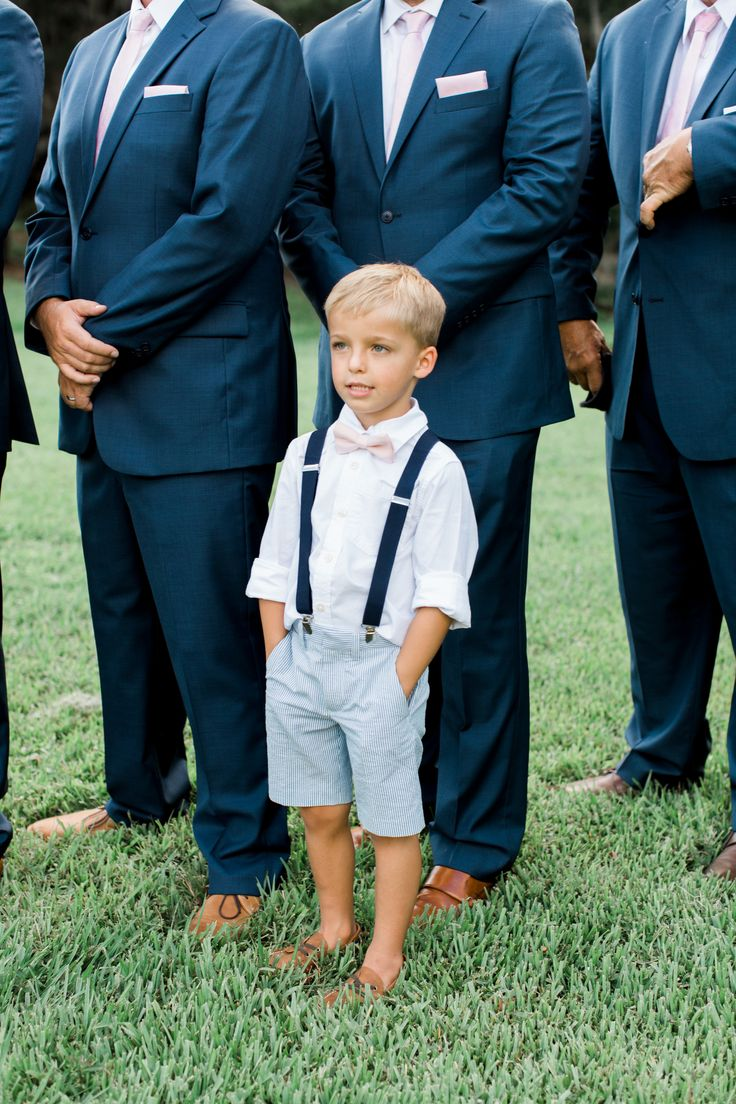 Preppy ring bearer, navy blue suspenders, light pink bowtie, seersucker shorts, brown loafers // Rachel Red Photography