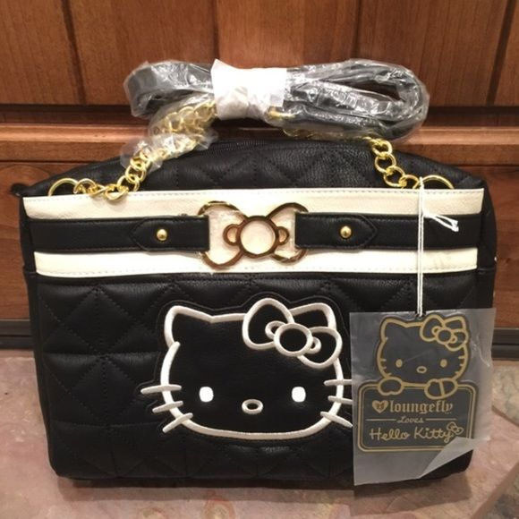Hello Kitty purse This Hello Kitty bag is super cute and is new with tags. It is black and white and has a quilt like pattern with a gold chain as a strap and a gold bow on the front of it. Hello Kitty Bags Shoulder Bags