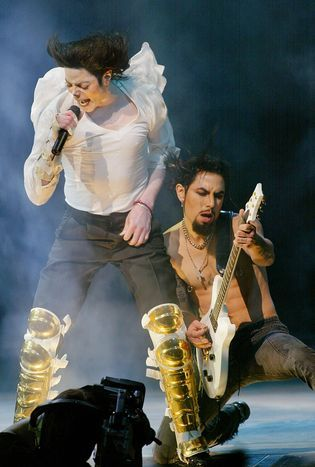 Michael Jackson & Dave Navarro: Michael is joined by guitarist Dave Navarro for a performance at the Democratic National Committee benefit concert at New York's Apollo Theater in 2002.