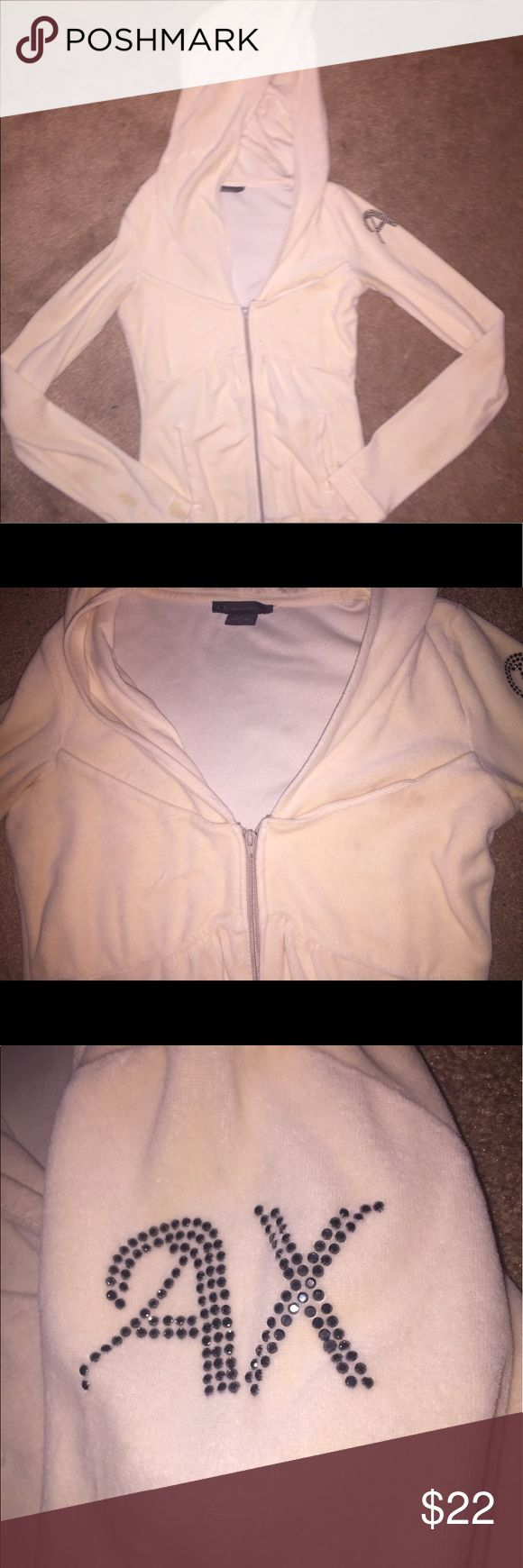 """Armani Exchange babydoll zip up jacket Armani Exchange babydoll style zip up jacket with fuzzy cloth-like material. Has AX on left arm in dark gray rhinestones. Two small stains my the wrist that I don't recall specifically trying to """"get out"""" but I will upon request. A/X Armani Exchange Tops Sweatshirts & Hoodies"""