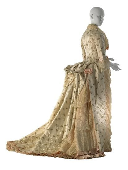 Afternoon dress (image 2) | House of Worth | Paris | 1876 | White satin with floral brocade; pink satin; pink satin ribbon | Museum of the City of New York | Item #: 62.190.3A-B