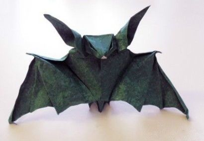 This paper craft is an Origami Bat, designed by designed by Andrea Mantler. The fold pattern for this bat is based on a pattern created by Georte Rhoads. T