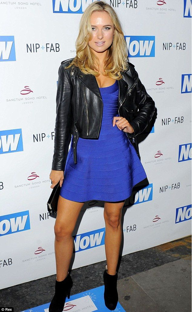 Kimberley Garner creates extra curves in blue bandage dress as she ...