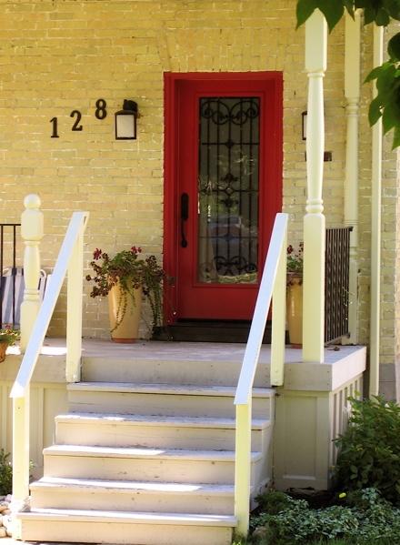 yellow brick house red door. red door. yellow housesred brick house door