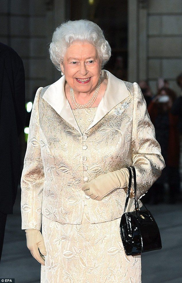 A beaming queen: As they headed into the event ahead of Queen Elizabeth, she was hot on their trail looking in high spirits while sporting an exquisite jacquard two-piece cream suit - Oct 2016