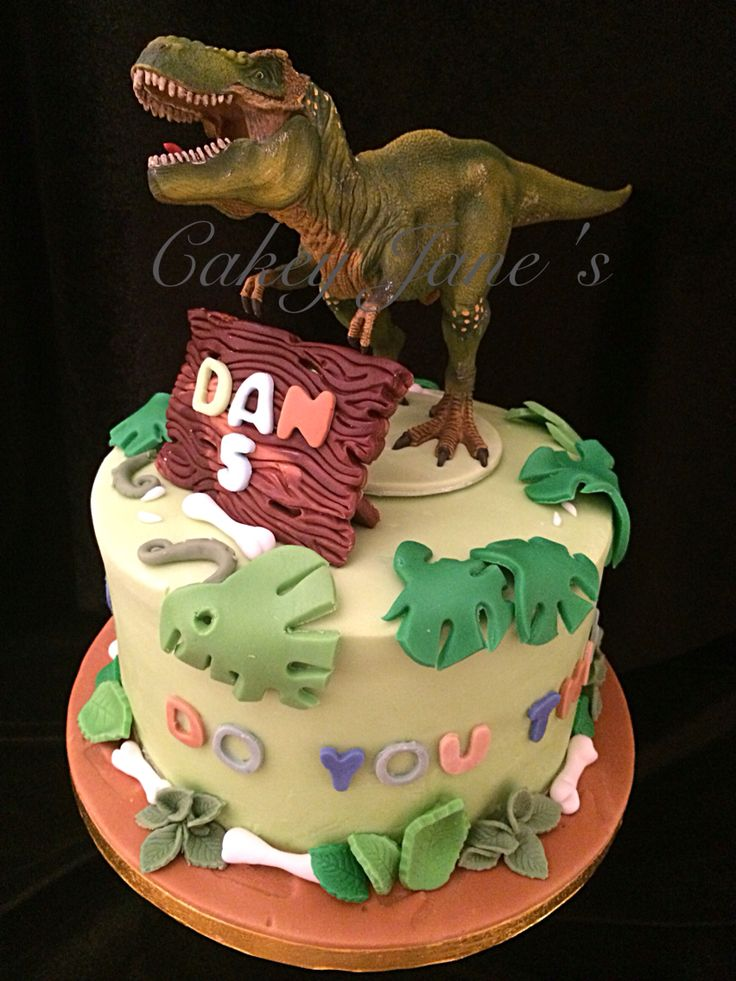 """Do you think he sau-rus?"" Dino Madeira sponge celebration cake with personalised plaque and toy topper"