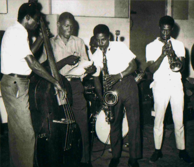 """Studio One recording session: LLOYD BREVETT, ROLAND ALPHONSO and JOHNNY """"DIZZY"""" MOORE from The Skatalites with legendary J.A. producer CLEMENT SEYMOUR """"COXSONE"""" DODD and drummer LLOYD KNIBS in the background."""