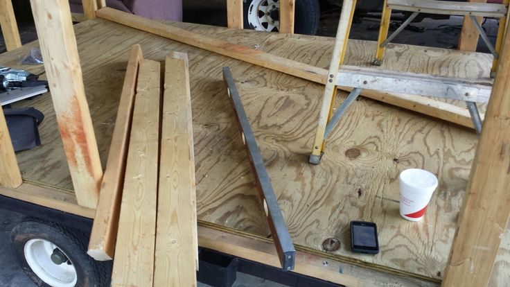 3/4 pressure treated plywood over 2x4 framing with R13 insulation in the batts.