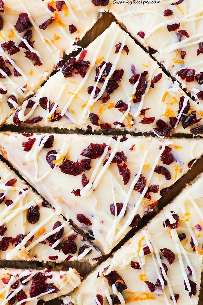 Cranberry Bliss Bars - Chewy brown butter blondies stuffed with white chocolate and cranberries then topped with a white chocolate, cream cheese frosting with cranberries and ora