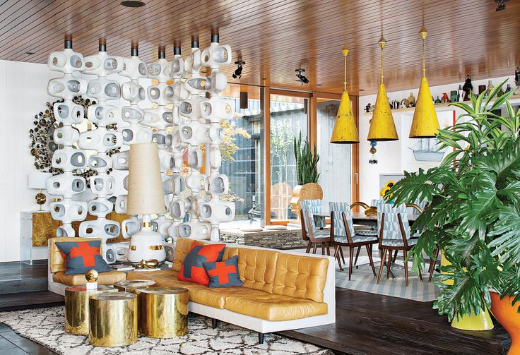 Although quietly set in Shelter Island's woodsy landscape, the New York home of Barneys' creative ambassador at large, Simon Doonan, is anything but mute. Filled with vibrant colors, theatrical accents, and of course, many of his husband's (Jonathan Adler) signature designs, this midcentury-modern-inspired home is filled with gusto.  Photo by Floto + Warner via Dwell Magazine