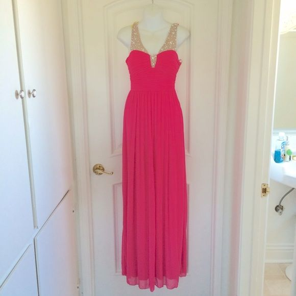 Bright pink and nude formal dress Bright neon pink formal gown with nude and jeweled detailing. I do have more pics if you want to see them. I think it runs a little big.  ✮ Condition:  NWOT - New without tag. There is a loose bead where the yellow tape is.   ✮ Closet Rules:  ⇢ NO SWAPS  ⇢ NO HOLDS  ⇢ PLEASE ASK FOR MEASUREMENTS ⇢ I USUALLY SHIP SAME OR NEXT BUSINESS DAY  #prom #formal #dance #winterformal #homecoming #elegant #elegantnight #formalnight #cruise #cruisedress #bright…