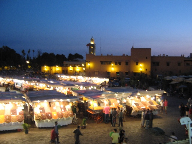 Jemaa el fna by night - music, dance, food, spices