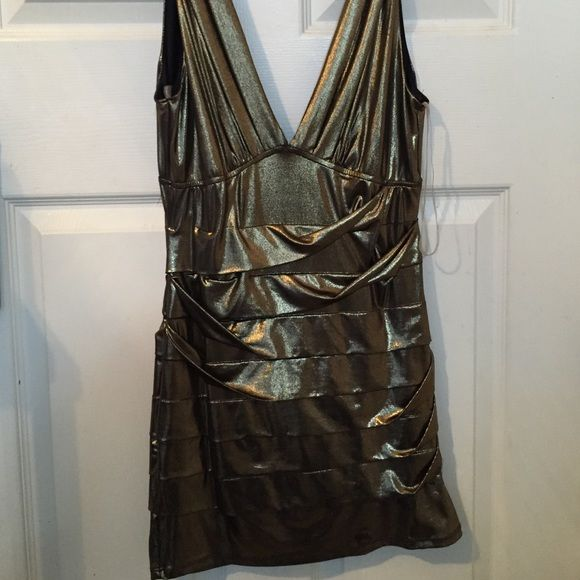 Gold bandage dress Bandage dress with plunging neckline. There is a slight tear that I have pictures above. It's not too notable but it's there. Forever 21 Dresses