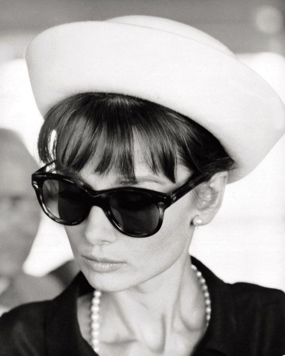 Audrey Hepburn #TimelessStyle Source http://www.vanityfair.com/hollywood/2013/04/photos-stars-audrey-hepburn-moment-miranda-kerr_slideshow_THE-HEPBURN-HALLMARK:-BIG-SHADES_10?mbid=social_pinterest