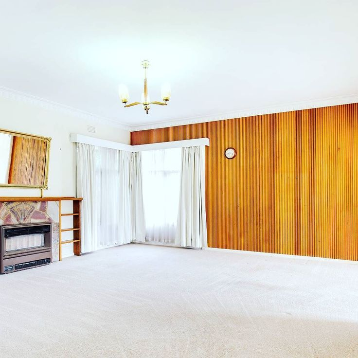 Wood panelling is so hot right now!  We're in love with this totally hot retro feature wall! 76 Duncans Road Werribee  Credit to @snapmediagroup for the pic #localhomestaging #homestaging #woodpanel #retro #vintage #fireplace #panels #makeover #interior #interiordecorating #realestatephotography #realestate