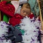 My baby girl asleep in a radio flyer at @JustSoFestival last year