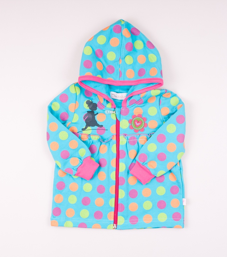 Blouse with hood. Made of 100% cotton. Zip fastening at front. Pattern with big, color dots and with flower motif on the front.